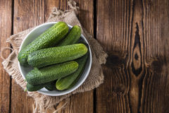 Some small Cucumbers. (close-up shot) on vintage wooden background Stock Image