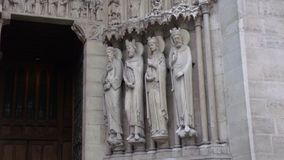 Some small sculptures embedded in the facade of the Cathedral of Notre Dame. In Paris, France royalty free stock photo