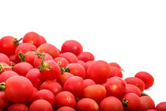 Some small tomatoes isolated on white background Royalty Free Stock Photos