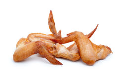 Some smoked chicken wings. Isolated on the white background Royalty Free Stock Image