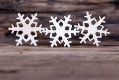 Some Snowflakes on Wood I Royalty Free Stock Images