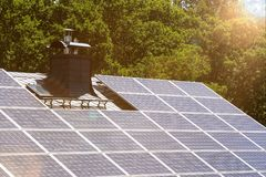 Solar cells on a house roof. Some solar cells on a house roof Stock Photo