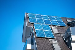 some solar panels on the roof of a private house royalty free stock photos