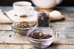 Some sort of tea. Some sort of dried tea in studio,with white cup and tea pot royalty free stock photos