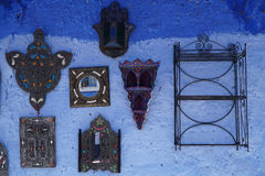 Some souvenirs hanged on wall in Chefchaouen, Morocco. Some souvenirs hanged on wall in the famous blue city of Chefchaouen in northern Morocco royalty free stock photos