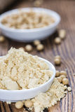 Some Soy Flour. On rustic wooden background (close-up shot royalty free stock photos