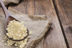 Some Soy Flour. On rustic wooden background (close-up shot royalty free stock photography