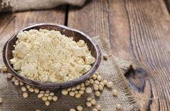 Some Soy Flour. On rustic wooden background (close-up shot stock photo