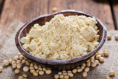 Some Soy Flour. On rustic wooden background (close-up shot royalty free stock image