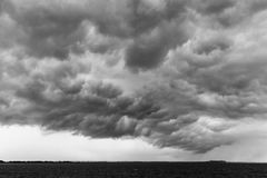 Some spectacular and menacing clouds over a lake, with a distant. Island in the background Stock Photography