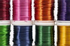 Colored metallic thread. Some spools of colored metallic thread stock photos