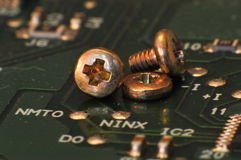 Some srew on board. Some svrew lay on circuit board royalty free stock photography