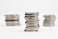 Some stacks of coins. Isolated on white Royalty Free Stock Photos