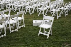 Some Stand Apart. One white chair stands apart from the formation Royalty Free Stock Image