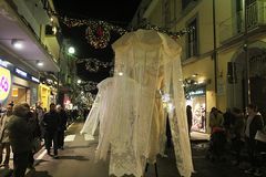 Stilt walkers sorrento. Some stilt walkers in the main street of sorrento in italy in christmas time Royalty Free Stock Photos