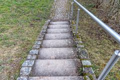 Stone stairs with a metal railing. Some Stone stairs with a new metal railing stock photo