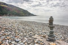 Some stones balancing on top of each to make a tower on a beach. Stones balancing on top of each to make a tower on a beach royalty free stock photos