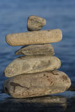 Some stones on each other with sea.  royalty free stock image