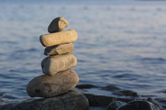 Some stones on each other with sea.  royalty free stock photos