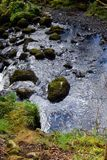 Some stones in the river. Lovely colour and texture of the water Stock Photos