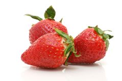 Some Strawberries. Red strawberries on white background Royalty Free Stock Photos