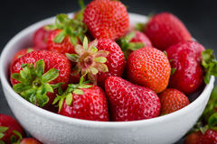 Some Strawberries on a dark slate slab. Portion of Strawberries as detailed close up shot on a slate slab; selective focus royalty free stock images