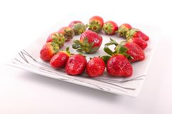 Some of Strawberries for diet. Fresh strawberries fruits on white dish royalty free stock photography
