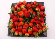 Some of strawberries. Fresh strawberries fruits on modern dish over white background Stock Photo