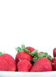 Some strawberries on white, space for text. A composition with some strawberries, white background,space for text on top, portrait cut royalty free stock photography