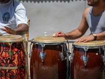 Street performers play rhythm on Mexican conga drums outdoors stock photography