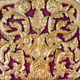 Some of the stucco pattern Thailand gold on a red background, Pu Stock Photo