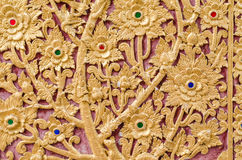 Some of the stucco pattern Thailand gold on a red background, Pu Stock Image