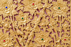Some of the stucco pattern Thailand gold on a red background, Pu Stock Images