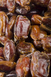 Some sun dried pitted dates. Some sun dried pitted organic dates Royalty Free Stock Photos