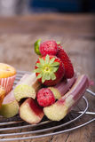 Some sweet fruits. Ingredients for muffins on a cake wire rack Stock Image