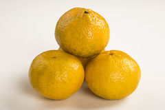 Some tangerines in a basket over a white background. Fresh fruits Stock Images