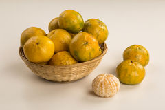Some tangerines in a basket over a white background. Fresh fruits Royalty Free Stock Image