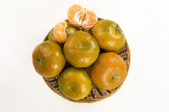 Some tangerines in a basket over a white background. Fresh fruits Royalty Free Stock Photo