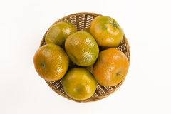 Some tangerines in a basket over a white background. Fresh fruits Royalty Free Stock Photography
