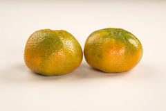 Some tangerines in a basket over a white background. Stock Photography