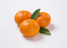 Some tangerines in a basket over a white background. Stock Image