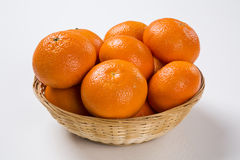 Some tangerines in a basket over a white background. Fresh fruits Royalty Free Stock Images
