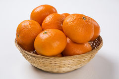 Some tangerines in a basket over a white background. Fresh fruits Stock Photography