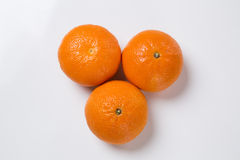 Some tangerines in a basket over a white background. Royalty Free Stock Photography