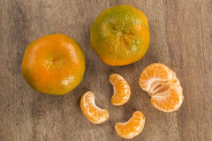 Some tangerines in a basket over a wooden surface. Fresh fruits Stock Photography