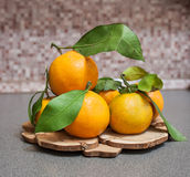 Some tangerins on a wooden stand Stock Photography