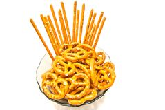 Some tasty salted pretzels and breadsticks. Tasty salted pretzels and breadsticks on white background closeup Stock Photos