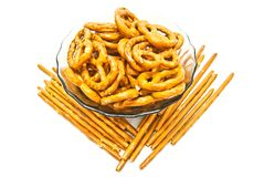 Some tasty salted pretzels and breadsticks on white. Many tasty salted pretzels and breadsticks on white closeup Stock Image