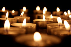 Some Tea Light Candles. On dark background Stock Images
