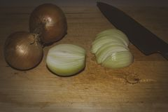 Some teardrops when cutting an onion in slices. With a knife royalty free stock photo